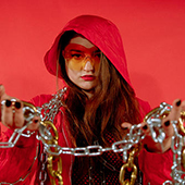 Carmen Aguirre holding chains